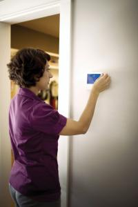 Lady Changing Thermostat